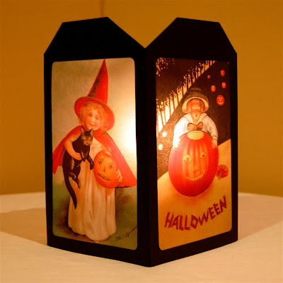 http://www.capadiadesign.com/2011/10/halloween-lantern-with-vintage-images.html#.VFGplhZO6O4