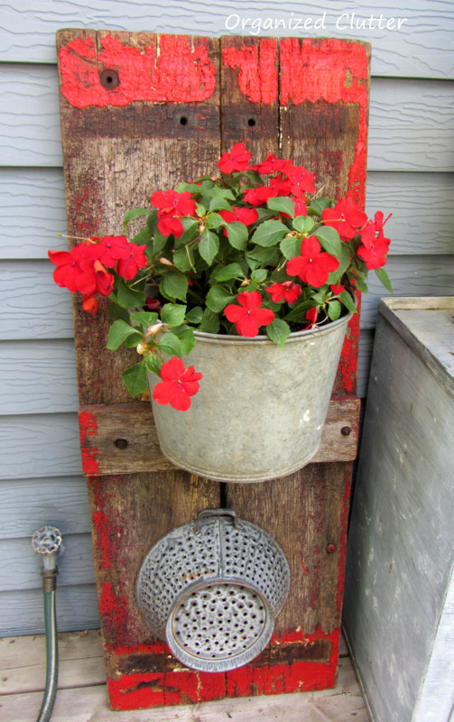 Wagon Board Backdrop for Galvanized Pail Planter www.organizedclutterqueen.blogspot.com