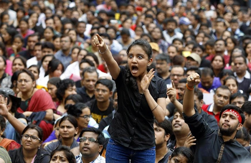An angry protester points her finger towards the Bangalore police chief during a protest against alleged police inaction after a six-year-old was raped at a school, in Bangalore, India, Saturday, July 19, 2014. More than 4,000 parents and relatives of children who attend the school shouted slogans against the school's administration Saturday and demanded that police arrest those involved in the July 2 incident, which was reported only this past week.
