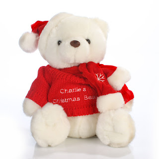 White Christmas teddy bear with Santa hat picture