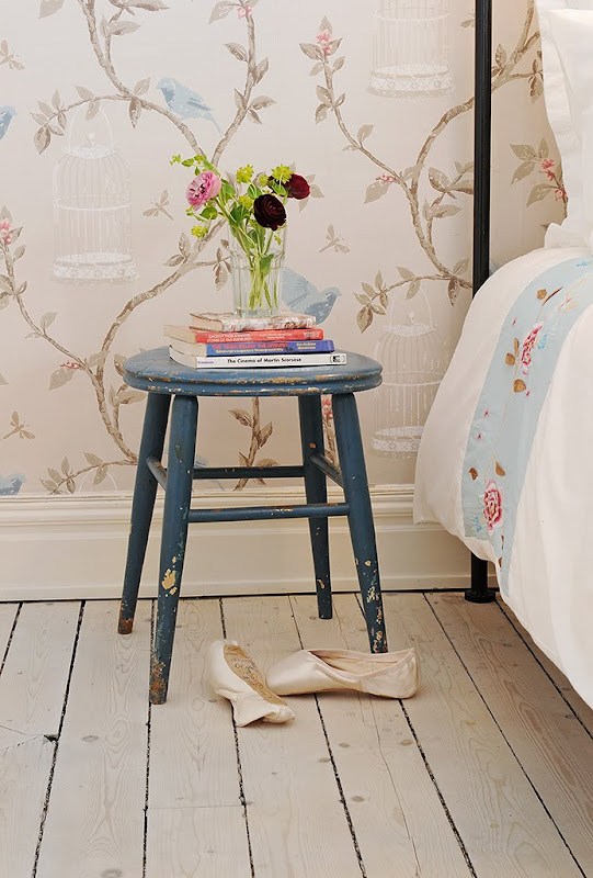 Close up of the blue stool doubling as a nightstand in a bedroom in a Swedish apartment