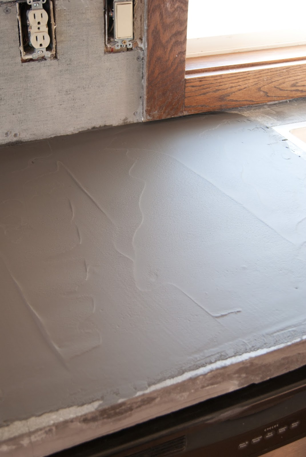 DIY Concrete Counters Poured over Laminate fixing the cracks
