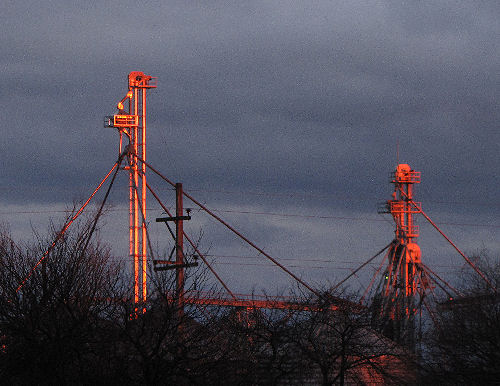 light reflected on grain elevator towers