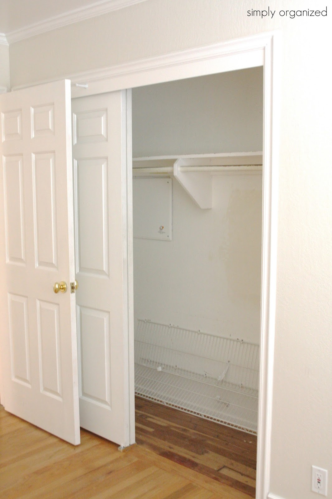 Then We Had The Standard Shelf With Rod Hanging Directly Under It. However,  What Is That At The Bottom 2 Feet Of The Closet?