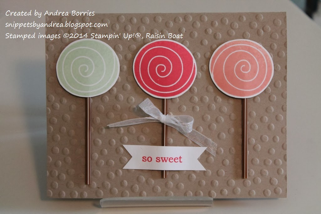 Card with polka dot-embossed background. Three stamped and punched circles with stick bases look like lollipops.