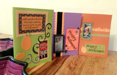A trio of halloween cards plus two spiderweb bowls