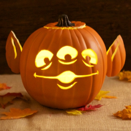 ... below to get the template to make your own three-eyed alien pumpkin