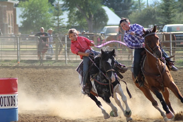 contestants riound the barrel in the crepe paper race at the Sheridan Elk's Youth Rodeo