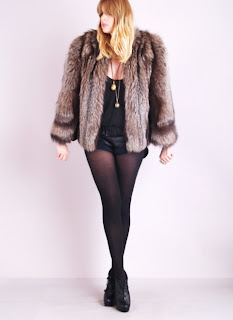 Vintage 1950's brown shaggy fox fur coat.