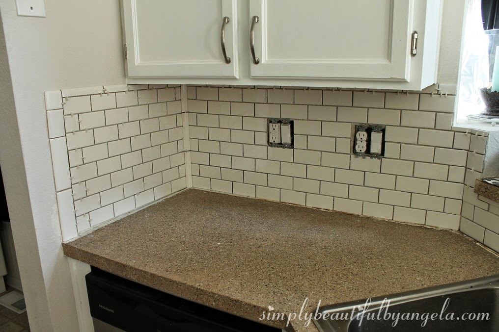 Simply beautiful by angela installing a tile backsplash for Tiling a backsplash inside corner
