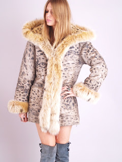 Vintage leopard print shearling fur coat with spotted lynx fur collar and hood.