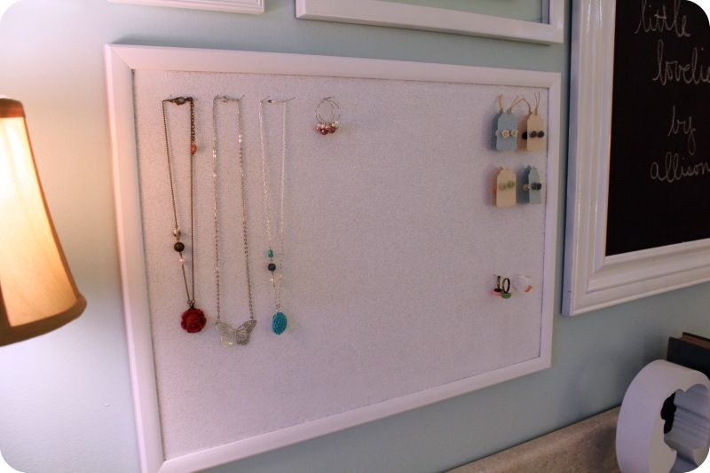 On the pretty statement wall  I have another spray painted cork board to  display my finished jewelry  I love to have my finished work hanging up    it. Craft Room