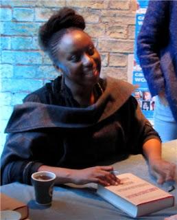 Chimamanda Ngozie Adichie signing books