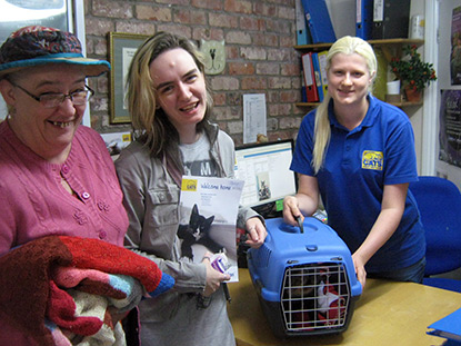 Tashie being collected by her new owners