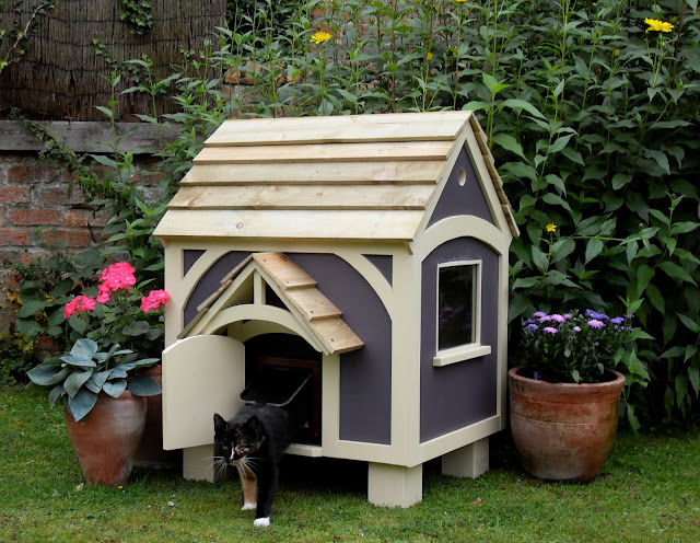 house for our cats, it's different than building a dog house. A cat ...