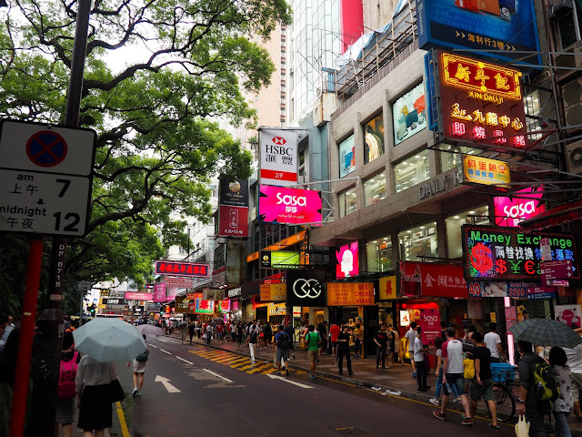 Average busy street in Tsim Sha Tsui, with shops, pedestrians and colourful signs