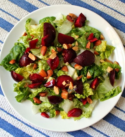 Plum almond arugula salad