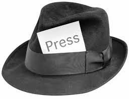 "Fedora hat with ""PRESS"" card stuck in the hat band"