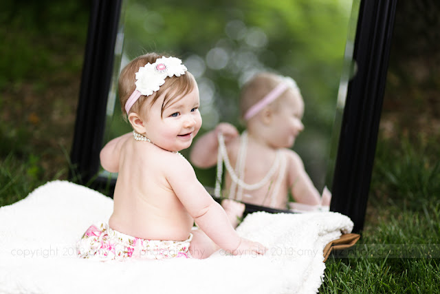 photo of a baby girl with a mirror