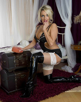 Blonde bombshell Danii Harwood in thigh high boots