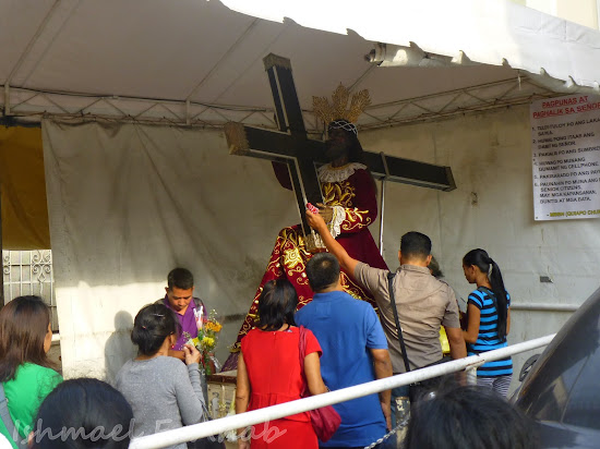 Devotees touching the replica of the Black Nazarene