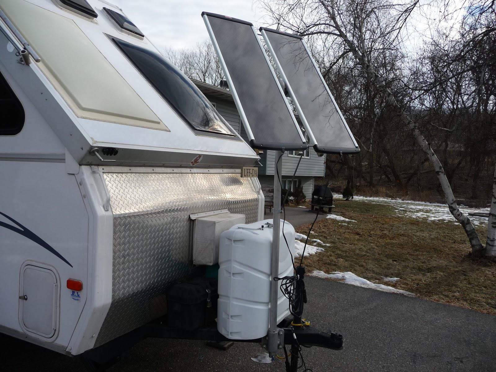 Dual 18 watt Coleman 1200 Solar Panels ... mounted on tongue