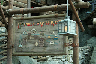 Wooden sign stating the exhibit title 'Legends of the Wild West'. Made to look old fashioned.