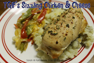TGIF's Sizzling Chicken & Cheese | A plate of seasoned chicken, mashed potatoes, and sizzling cheesy peppers and onion #copycat #recipe
