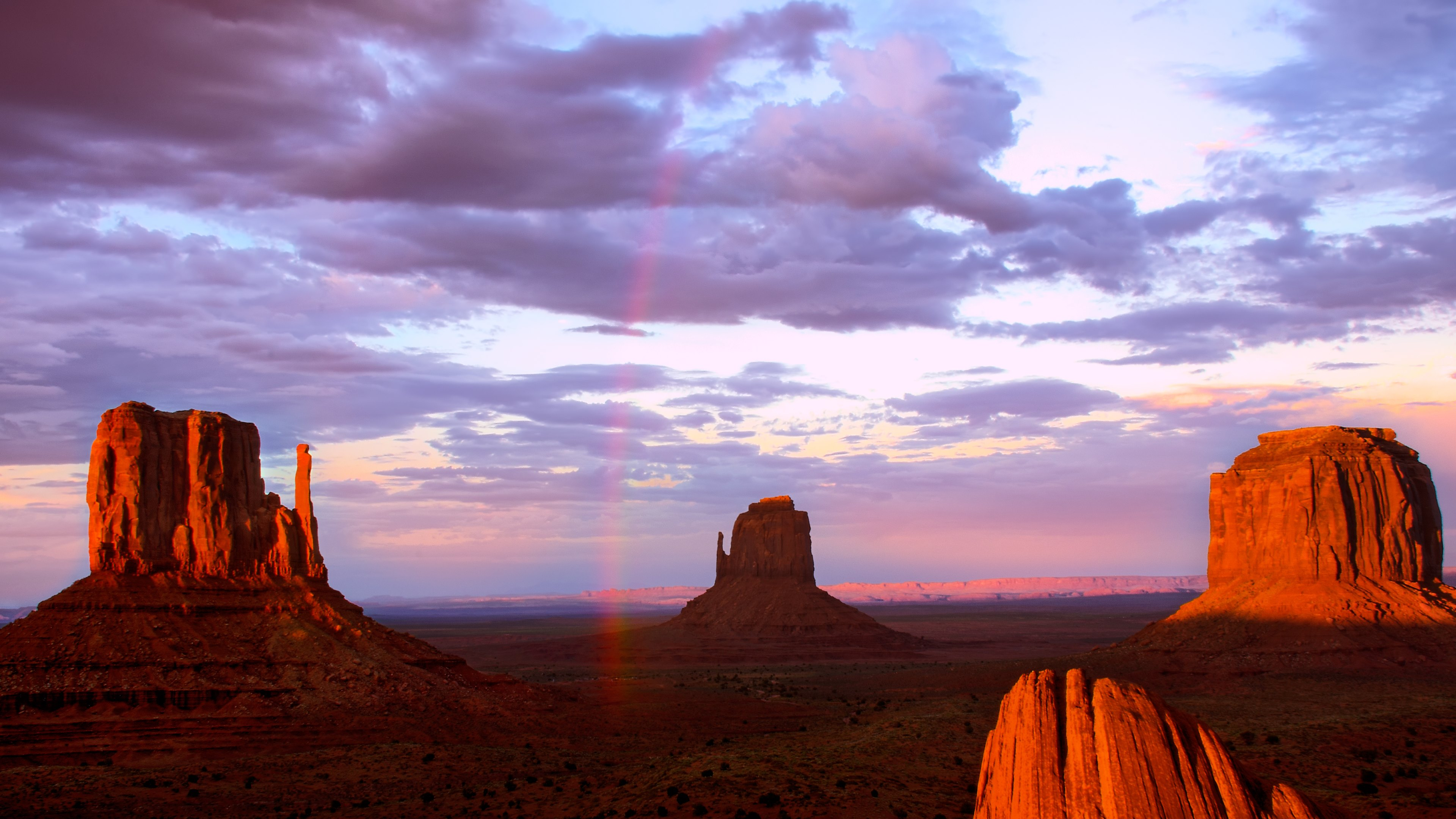rainbow in monument valley