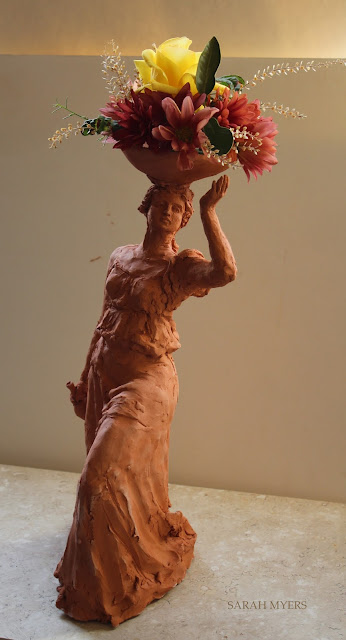 woman, sculpture, bowl, figure, terracotta, ceramic, earthenware, red, Sarah, Myers, flowers, lady, escultura, art, arte, clay, bottle, bouquet, rose, chrysanthemums, mums, yellow, orange, new, artwork, classic, figurative, renaissance, artist, tall, beautiful, spontaneous, kunst, move, walk, stride, arrangement, decor, deco, glow, light, bright