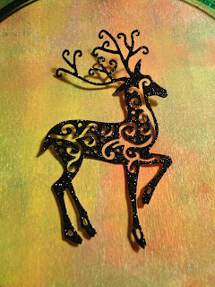 Reindeer die cut from black glitter card