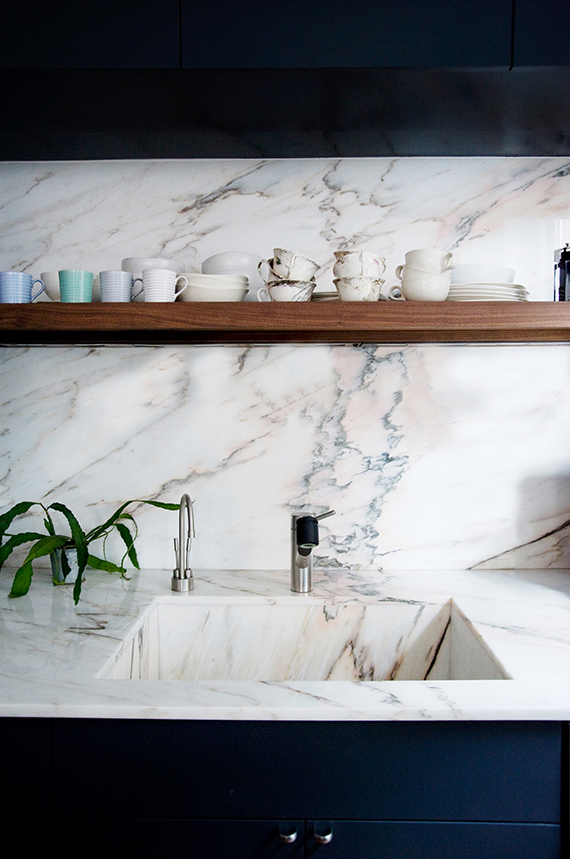 KITCHEN DETAIL:  Marble and dark blue cabinetry | Image via Ensemble Architecture, DPC
