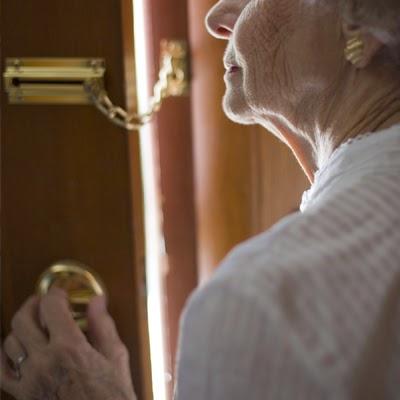 very-old-woman-open-door