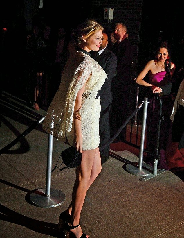 By confidently, The blonde beauty, Kate Upton looked more comfortable in this second dress, she removed cape at the Met Gala after party on Monday, April 5, 2014.