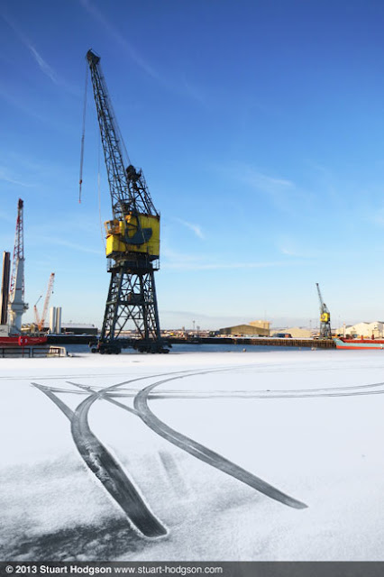 Hartlepool Docks with tyre tracks in a snow covered yard