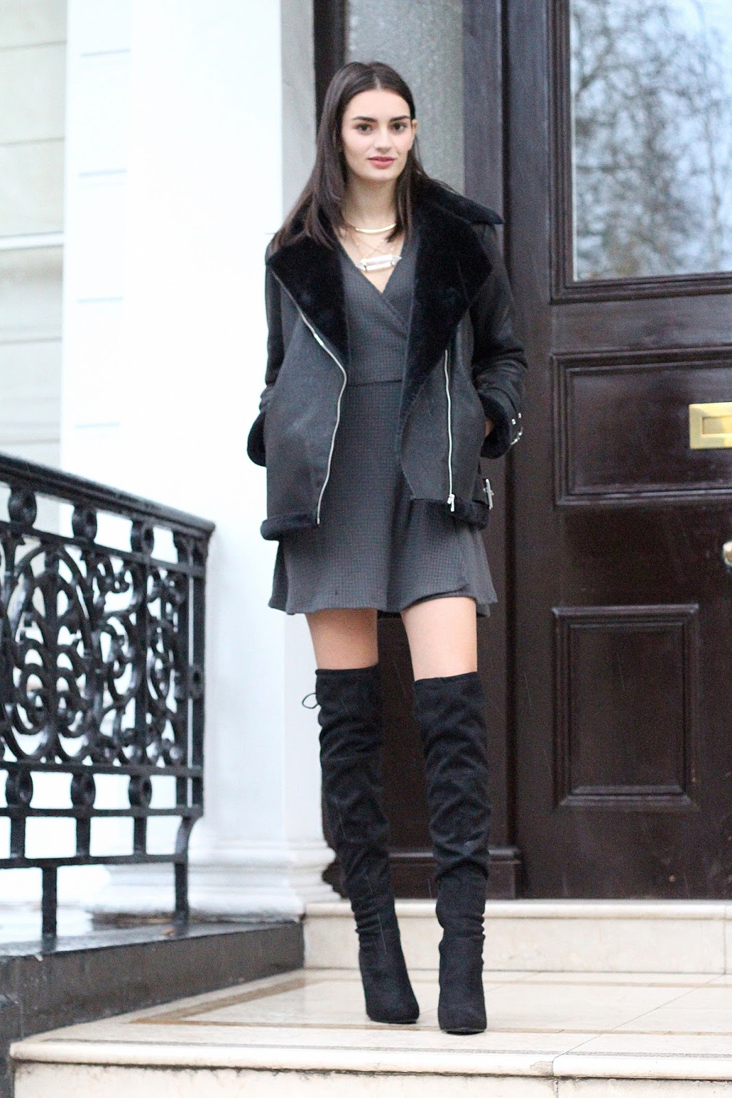 peexo fashion blogger wearing winter outfit with knee high boots