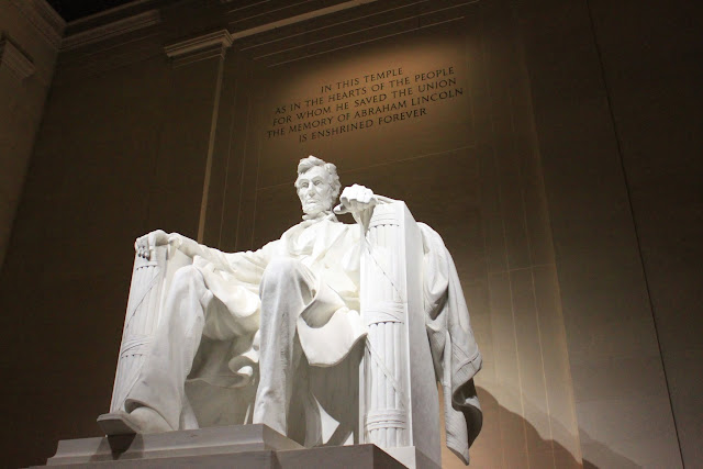 The side view of President Abraham Lincoln's statue at night at Lincoln Memorial in Washington DC, USA