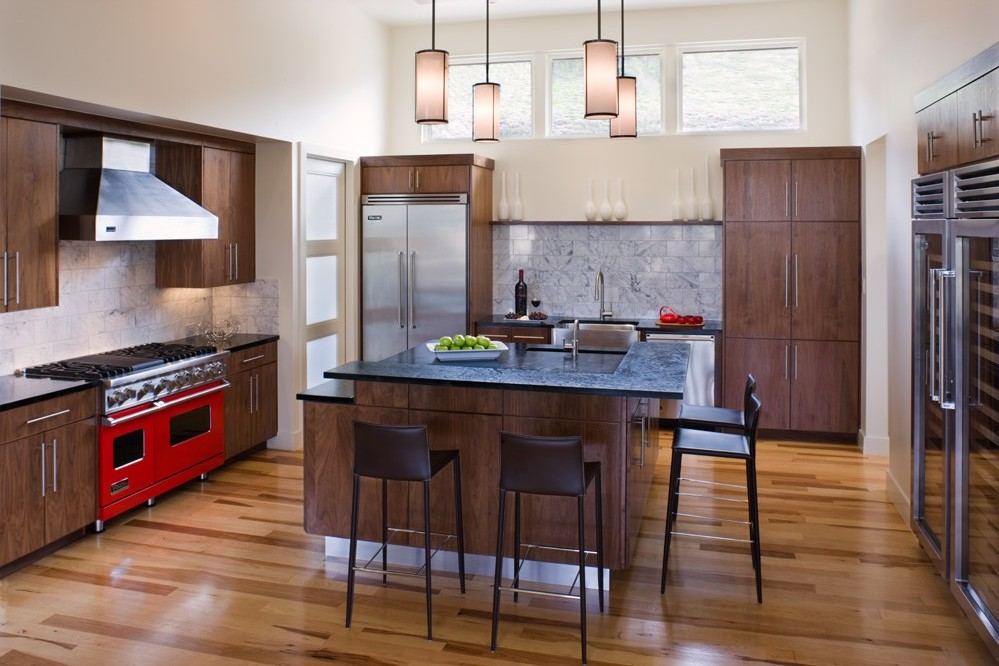 Photo Of Modern Kitchen Interiors With Dark Brown Furniture And Red Oven