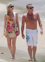 Michael Flatley showed off his impressive physique as he wandered down a beach in Barbados with wife Niamh