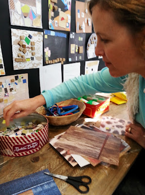 A woman selecting paper for her collage in the children's room at The Daylight Moon exhibition.
