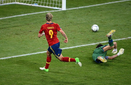 Spanish forward Fernando Torres scores his third goal in the Euro 2012 to win the Golden Boot award