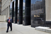 In this July 28, 2015, file photo, a man walks out of the Export-Import Bank of the United States in Washington. A strong coalition of establishment-backed Republicans and House Democrats voted overwhelmingly Oct. 27 to revive the Export-Import Bank, dealing a defeat to tea party conservatives and Speaker Paul Ryan. (Credit: AP Photo/Jacquelyn Martin) Click to Enlarge.