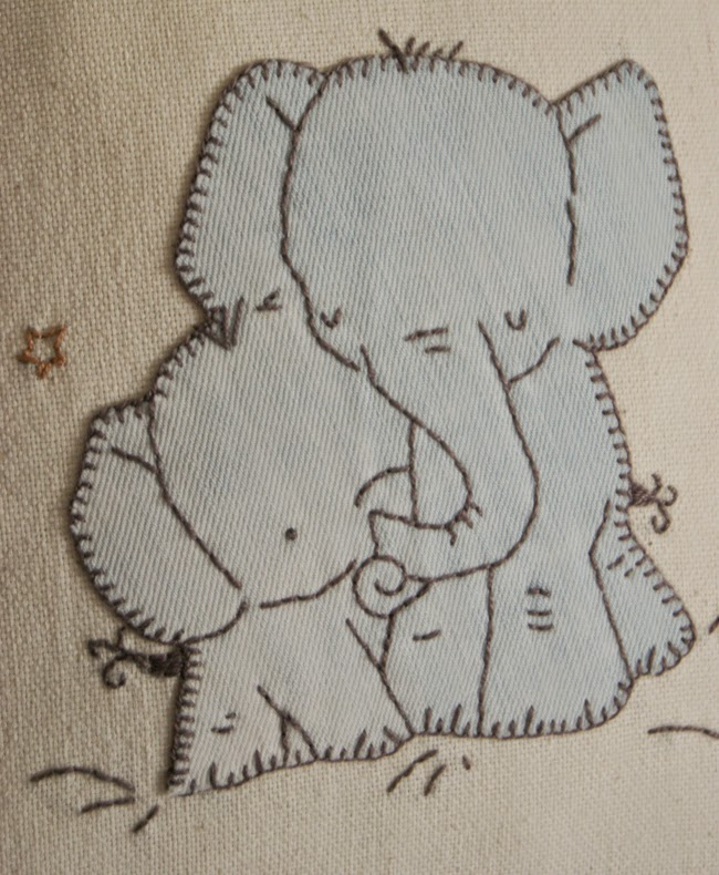 Pillow with elephant family applique based on Kit Chase`s illustration