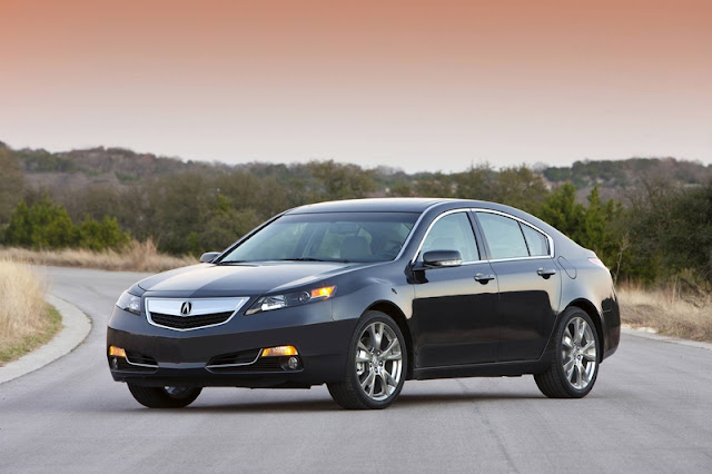 Front 3/4 view of 2012 Acura TL on road