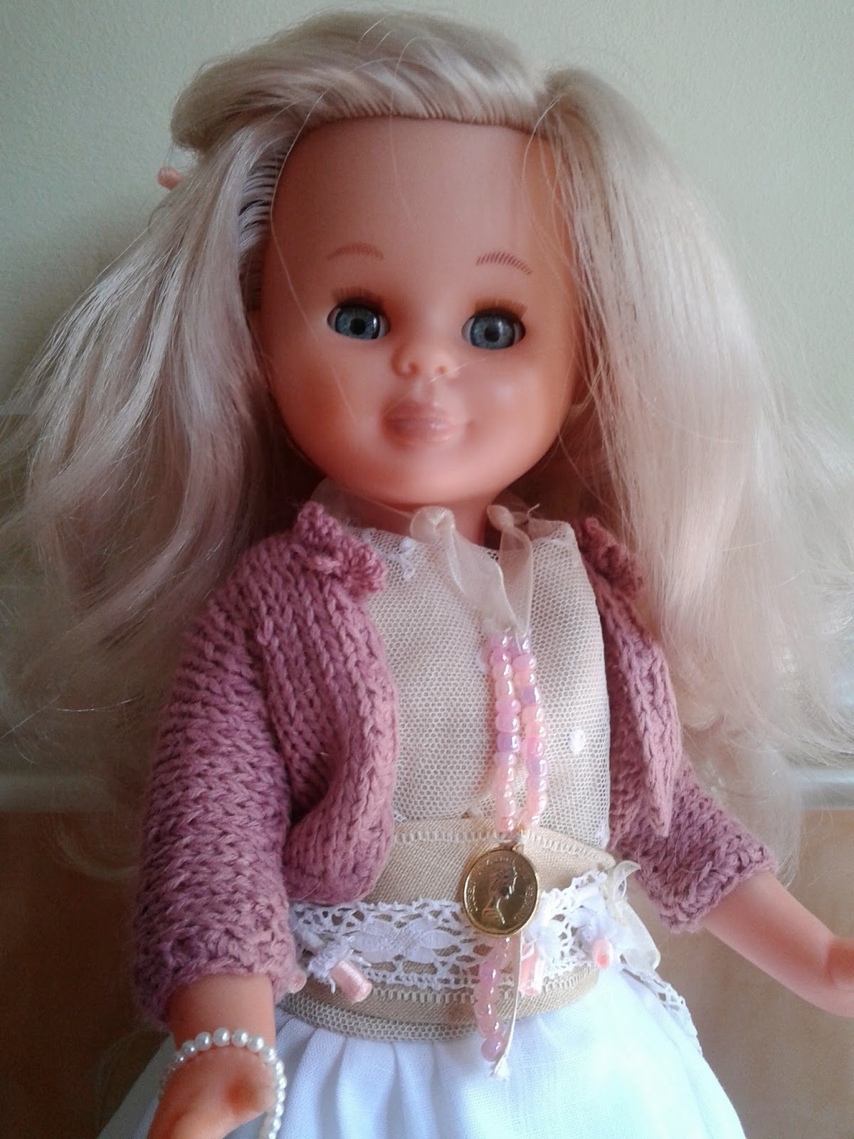 Chaqueta de punto para muñeca Nancy