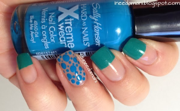 half nude green nails with blue polka dots sally hansen xtreme wear blue me away