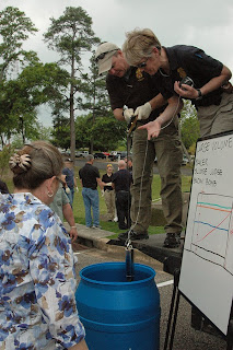 Instructors demonstrate how to get samples from a large or an underground storage tank.