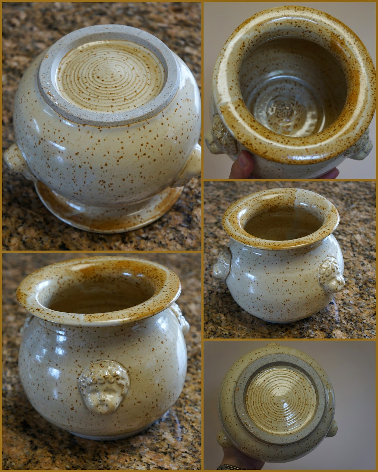 Large handmade stoneware pottery vase / pot with doll faces on sides.