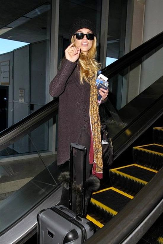 We're pretty sure if the fashions made an impression on the high tea attendees.  Cause the leggy lady of AnnaLynne McCord was managed to strut her stuff down by ease while walking out from her private plane at the Airport in Los Angeles, CA, USA on Monday, January 12, 2015.