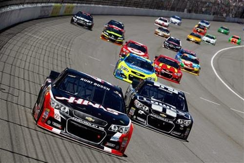 Kurt Busch leads Jimmie Johnson into turn 1; Credit: Brian Lawdermilk/NASCAR via Getty Images